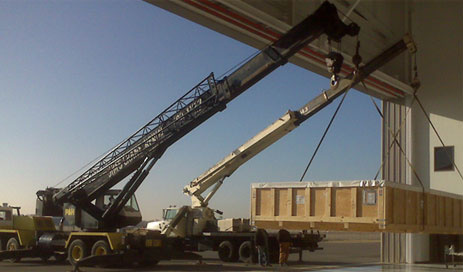 cranes lifting crate
